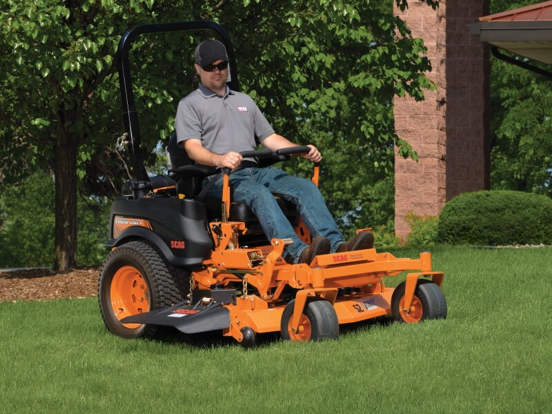 man cutting with scag zero turn mower